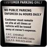 tow away parking sign